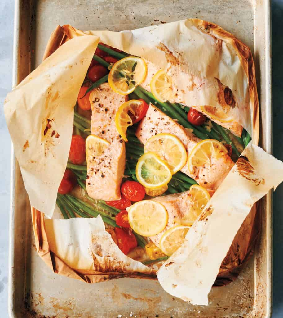Salmon, haricot verts, and tomatoes cooked in parchment.