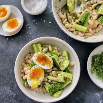 this shows the smashed cucumber and bean salad with an egg on top